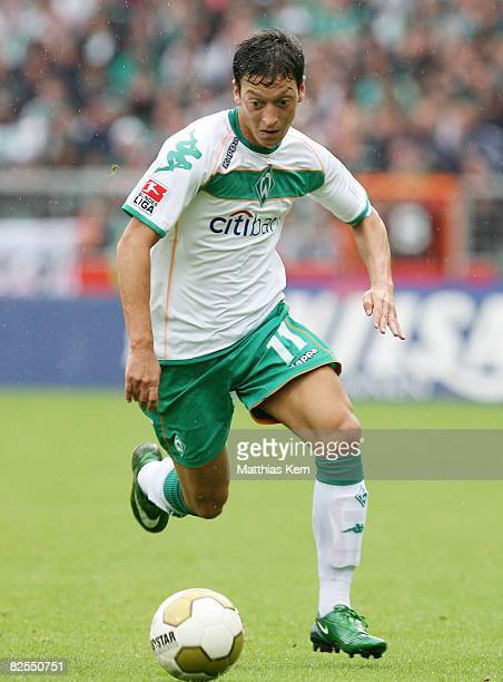 Mesut Oezil of Bremen runs with the ball during the Bundesliga match between SV Werder Bremen and FC Schalke 04 at the Weserstadion on August 23 2008...