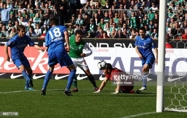 Mesut Oezil of Bremen scores his team's 4th goal during the Bundesliga match between Werder Bremen and SC Freiburg at the Weser Stadium on April 10...