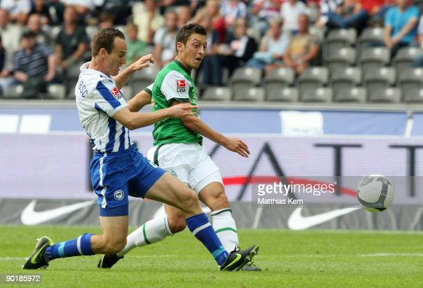 Mesut Oezil of Bremen scores the first goal during the Bundesliga match between Hertha BSC Berlin and SV Werder Bremen at the Olympic Stadium on...