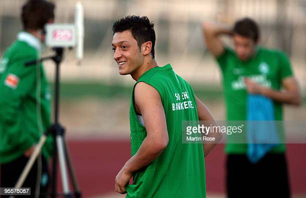 Mesut Oezil of Bremen smiles during the Werder Bremen training session at the Al Wasl training ground on January 4 2010 in Dubai United Arab Emirates