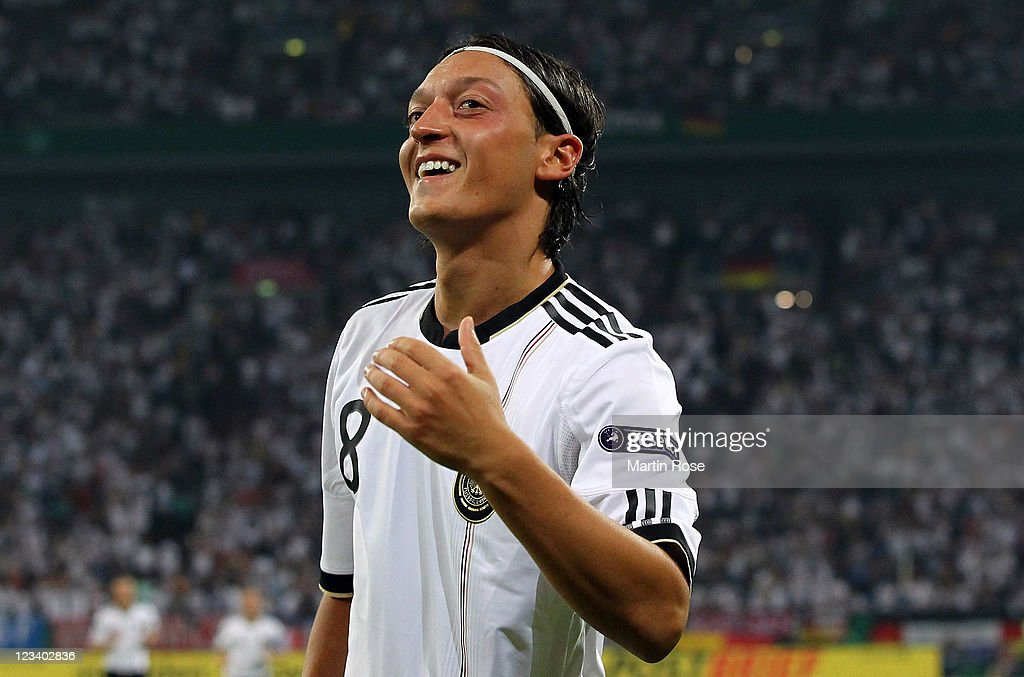 <a gi-track='captionPersonalityLinkClicked' href=/galleries/search?phrase=Mesut+Oezil&family=editorial&specificpeople=764075 ng-click='$event.stopPropagation()'>Mesut Oezil</a> (#8) of Germany celebrates after he scores his team's 4th goal during the UEFA EURO 2012 qualifying match between Germany and Austria at Veltins-Arena on September 2, 2011 in Gelsenkirchen, Germany.