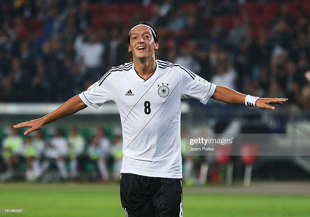 <a gi-track='captionPersonalityLinkClicked' href=/galleries/search?phrase=Mesut+Oezil&family=editorial&specificpeople=764075 ng-click='$event.stopPropagation()'>Mesut Oezil</a> of Germany celebrates after scoring his team's second goal the FIFA 2014 World Cup Qualifier group C match between Germany and Faeroe Islands at AWD Arena on September 7, 2012 in Hannover, Germany.