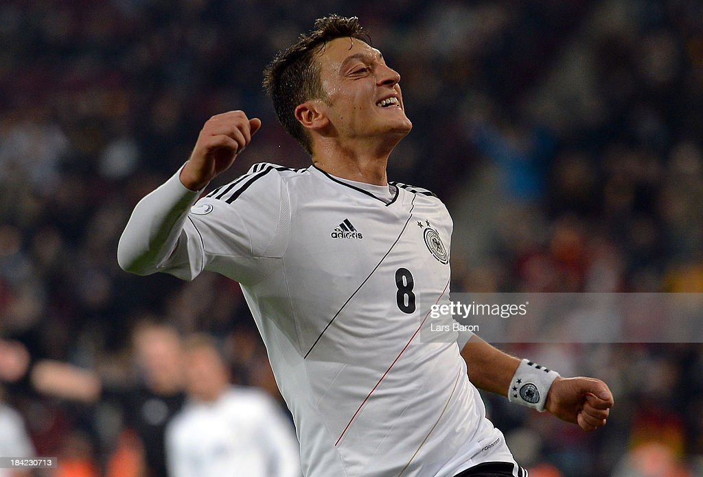 <a gi-track='captionPersonalityLinkClicked' href=/galleries/search?phrase=Mesut+Oezil&family=editorial&specificpeople=764075 ng-click='$event.stopPropagation()'>Mesut Oezil</a> of Germany celebrates after scoring his teams third goal during the FIFA 2014 World Cup Qualifying Group C match between Germany and Republic of Ireland at RheinEnergieStadion on October 11, 2013 in Cologne, Germany.