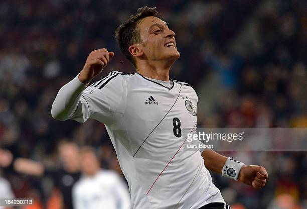 Mesut Oezil of Germany celebrates after scoring his teams third goal during the FIFA 2014 World Cup Qualifying Group C match between Germany and...