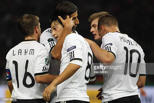 Mesut Oezil of Germany celebrates his team's second goal with team mates Philipp Lahm Sami Khedira Toni Kroos and Miroslav Klose during the EURO 2012...