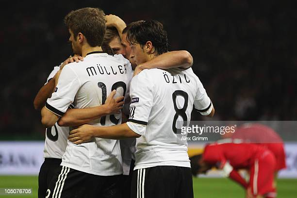 Mesut Oezil of Germany celebrates his team's second goal with team mates during the EURO 2012 group A qualifier match between Germany and Turkey at...