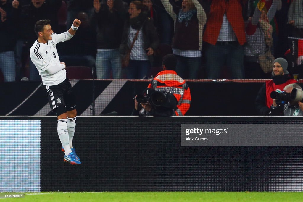 <a gi-track='captionPersonalityLinkClicked' href=/galleries/search?phrase=Mesut+Oezil&family=editorial&specificpeople=764075 ng-click='$event.stopPropagation()'>Mesut Oezil</a> of Germany celebrates his team's third goal during the FIFA 2014 World Cup Group C qualifiying match between Germany and Republic of Ireland at RheinEnergieStadion on October 11, 2013 in Cologne, Germany.