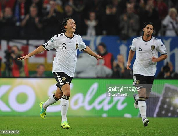 Mesut Oezil of Germany celebrates scoring his goal during the UEFA EURO 2012 Group A qualifying match between Germany and Belgium at EspritArena on...
