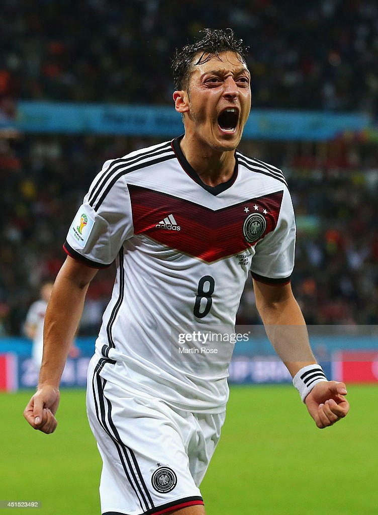 <a gi-track='captionPersonalityLinkClicked' href=/galleries/search?phrase=Mesut+Oezil&family=editorial&specificpeople=764075 ng-click='$event.stopPropagation()'>Mesut Oezil</a> of Germany celebrates scoring his team's second goal in extra time during the 2014 FIFA World Cup Brazil Round of 16 match between Germany and Algeria at Estadio Beira-Rio on June 30, 2014 in Porto Alegre, Brazil.