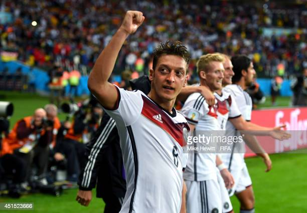 Mesut Oezil of Germany celebrates scoring his team's second goal during the 2014 FIFA World Cup Brazil Round of 16 match between Germany and Algeria...