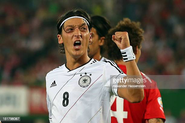 Mesut Oezil of Germany celebrates scoring the 2nd team goal during the FIFA 2014 World Cup Qualifier group C match between Austria and Germany at...