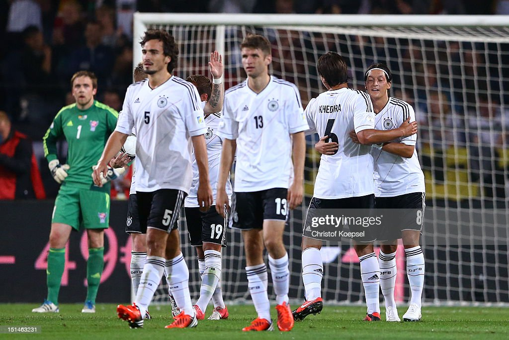 Mesut Oezil of Germany (R) celebrates the second goal with Sami Khedira (2nd R) during the FIFA 2014 World Cup Qualifier group C match between Germany and Faeroe Islands at AWD Arena on September 7, 2012 in Hanover, Germany.