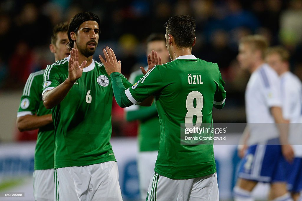 Mesut Oezil of Germany celebrates with teammates after scoring his team's second goal during the FIFA 2014 World Cup Qualifier match between Faeroe Islands and Germany on September 10, 2013 in Torshavn, Denmark.