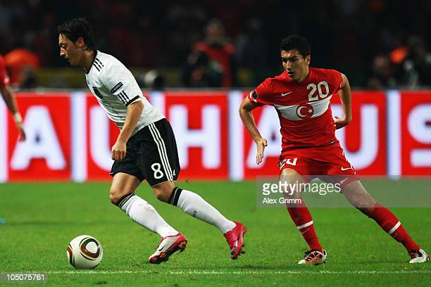 Mesut Oezil of Germany eludes Nuri Sahin of Turkey during the EURO 2012 group A qualifier match between Germany and Turkey at the Olympic Stadium on...