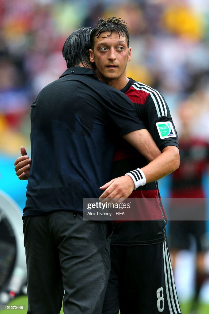 <a gi-track='captionPersonalityLinkClicked' href=/galleries/search?phrase=Mesut+Oezil&family=editorial&specificpeople=764075 ng-click='$event.stopPropagation()'>Mesut Oezil</a> of Germany hugs with head coach <a gi-track='captionPersonalityLinkClicked' href=/galleries/search?phrase=Joachim+Loew&family=editorial&specificpeople=215315 ng-click='$event.stopPropagation()'>Joachim Loew</a> of Germany as being replaced during the 2014 FIFA World Cup Brazil Group G match between USA and Germany at Arena Pernambuco on June 26, 2014 in Recife, Brazil.