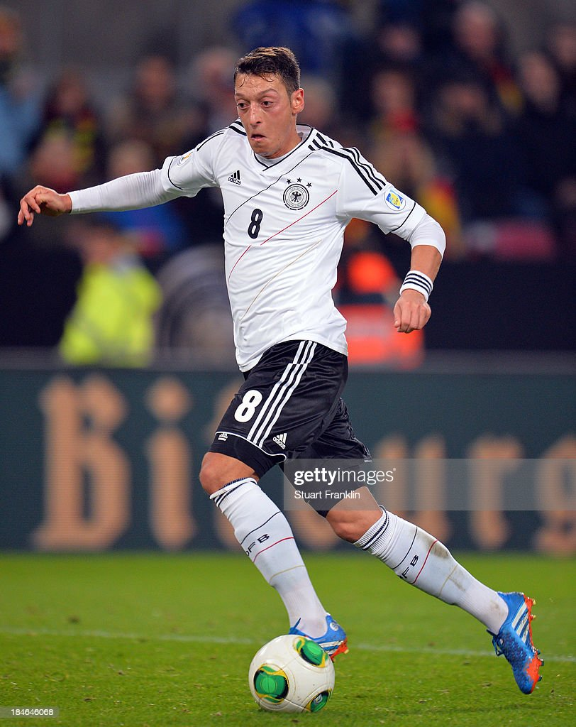 <a gi-track='captionPersonalityLinkClicked' href=/galleries/search?phrase=Mesut+Oezil&family=editorial&specificpeople=764075 ng-click='$event.stopPropagation()'>Mesut Oezil</a> of Germany in action during the FIFA world Cup 2014 qualification match between Germany and Republic of Ireland at the Rheinenergy stadium on October 11, 2013 in Cologne, Germany.