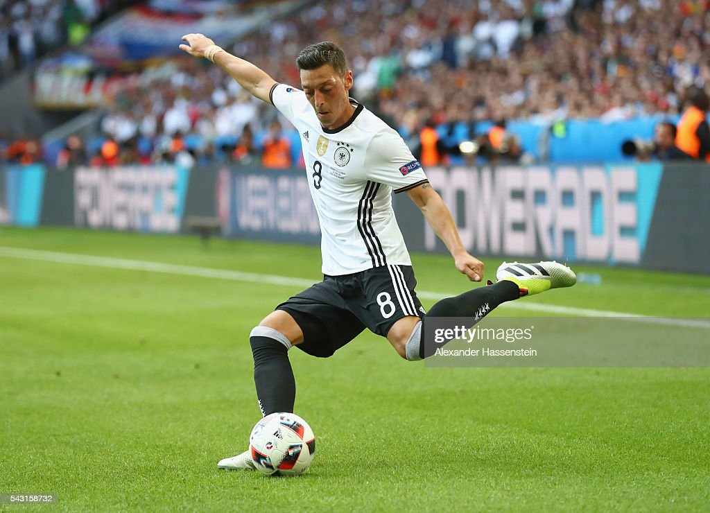 <a gi-track='captionPersonalityLinkClicked' href=/galleries/search?phrase=Mesut+Oezil&family=editorial&specificpeople=764075 ng-click='$event.stopPropagation()'>Mesut Oezil</a> of Germany in action during the UEFA EURO 2016 round of 16 match between Germany and Slovakia at Stade Pierre-Mauroy on June 26, 2016 in Lille, France.