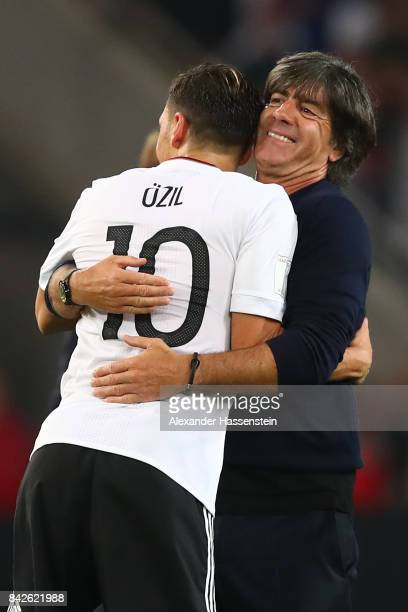 Mesut Oezil of Germany is being hugged by Joachim Loew national coach of Germany after the FIFA 2018 World Cup Qualifier between Germany and Norway...