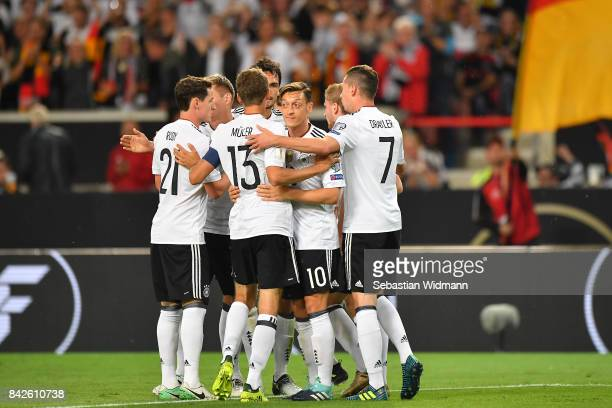 Mesut Oezil of Germany is celebrated by his team after he scored Germany's first goal to make it 10 during the FIFA 2018 World Cup Qualifier between...