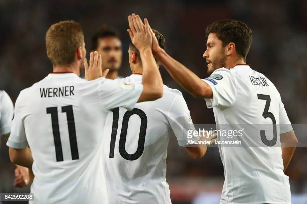 Mesut Oezil of Germany is celebrated by Jonas Hector of Germany and Timo Werner of Germany after he scored Germany's first goal during the FIFA 2018...