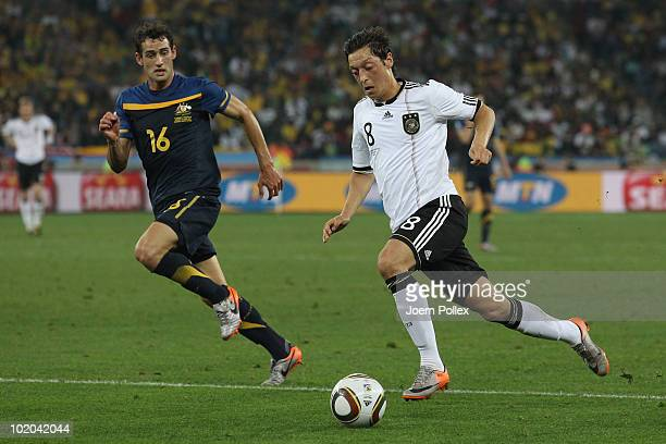 Mesut Oezil of Germany is closed down by Carl Valeri of Australia during the 2010 FIFA World Cup South Africa Group D match between Germany and...