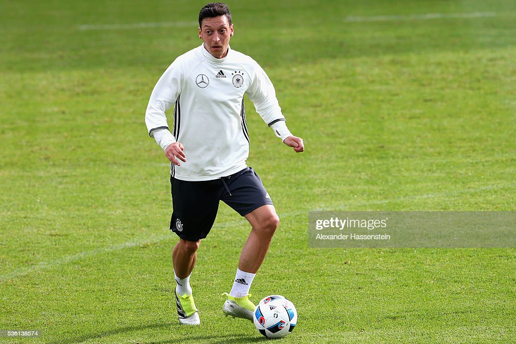 <a gi-track='captionPersonalityLinkClicked' href=/galleries/search?phrase=Mesut+Oezil&family=editorial&specificpeople=764075 ng-click='$event.stopPropagation()'>Mesut Oezil</a> of Germany plays the ball during a training session at Stadio communale on day 8 of the German national team trainings camp on May 31, 2016 in Ascona, Switzerland.