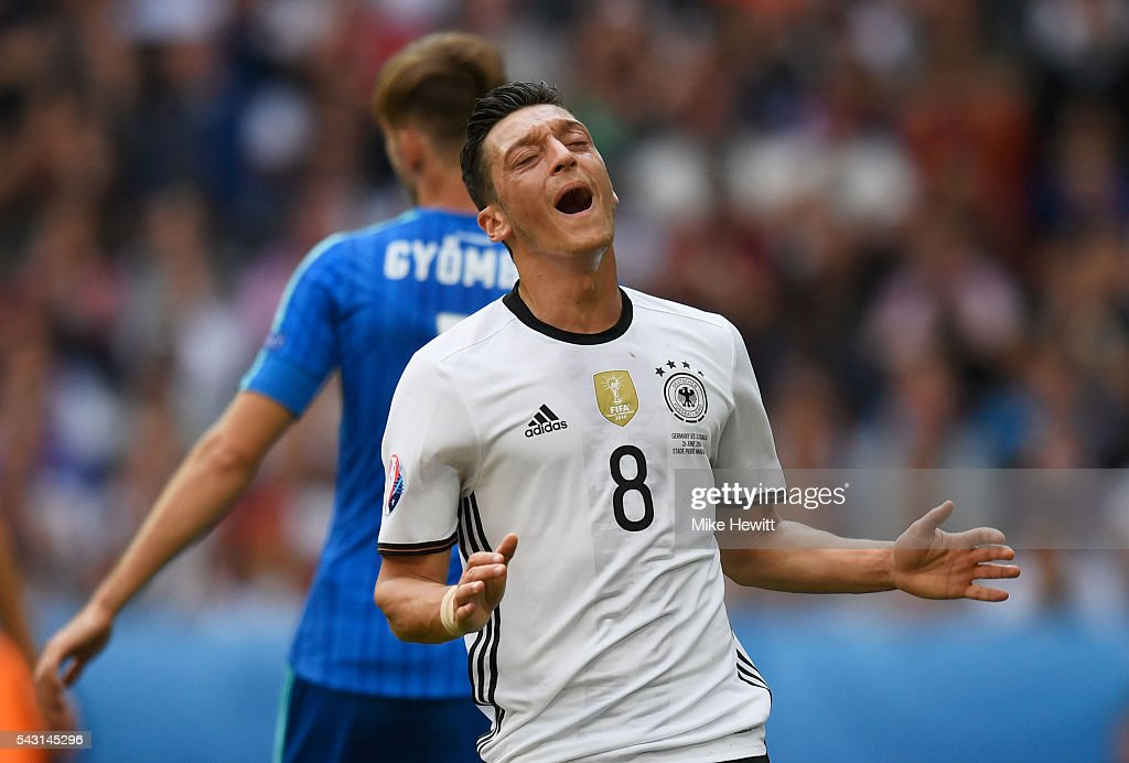 <a gi-track='captionPersonalityLinkClicked' href=/galleries/search?phrase=Mesut+Oezil&family=editorial&specificpeople=764075 ng-click='$event.stopPropagation()'>Mesut Oezil</a> of Germany reacts after missing a chance during the UEFA EURO 2016 round of 16 match between Germany and Slovakia at Stade Pierre-Mauroy on June 26, 2016 in Lille, France.