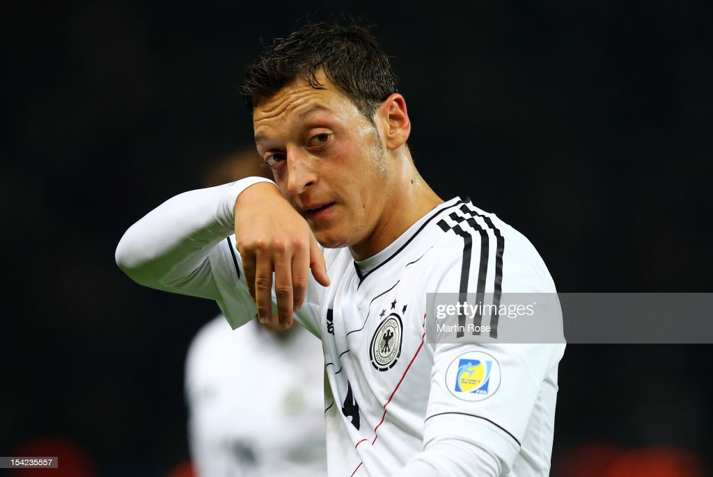 <a gi-track='captionPersonalityLinkClicked' href=/galleries/search?phrase=Mesut+Oezil&family=editorial&specificpeople=764075 ng-click='$event.stopPropagation()'>Mesut Oezil</a> of Germany reacts during during the FIFA 2014 World Cup Qualifier group C match between Germany and Sweden at Olympiastadion on October 16, 2012 in Berlin, Germany.