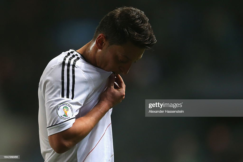 <a gi-track='captionPersonalityLinkClicked' href=/galleries/search?phrase=Mesut+Oezil&family=editorial&specificpeople=764075 ng-click='$event.stopPropagation()'>Mesut Oezil</a> of Germany reacts during the FIFA 2014 World Cup qualifier group C match between Kazakhstan and Germany at Astana Arena on March 22, 2013 in Astana, Kazakhstan.