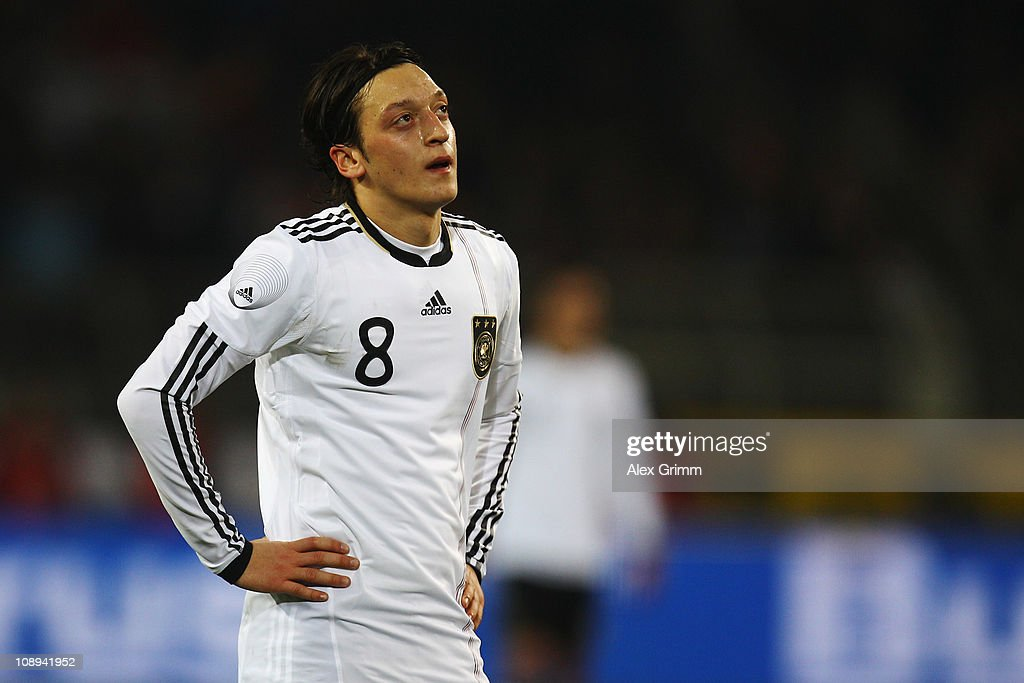 <a gi-track='captionPersonalityLinkClicked' href=/galleries/search?phrase=Mesut+Oezil&family=editorial&specificpeople=764075 ng-click='$event.stopPropagation()'>Mesut Oezil</a> of Germany reacts during the international friendly match between Germany and Italy at Signal Iduna Park on February 9, 2011 in Dortmund, Germany.