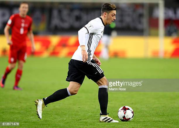 Mesut Oezil of Germany runs during the FIFA 2018 World Cup Qualifier between Germany and Czech Republic at Volksparkstadion on October 8 2016 in...