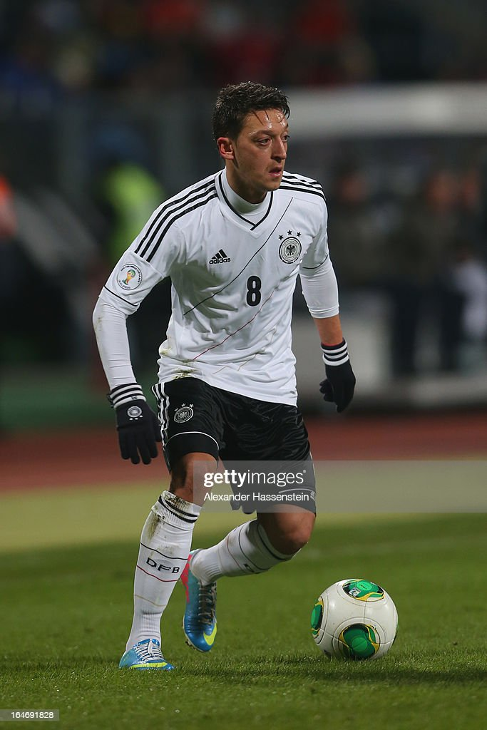 Mesut Oezil of Germany runs with the ball during the FIFA 2014 World Cup qualifier group C match between Germany and Kazakhstan at Gundig-Stadion on March 26, 2013 in Nuremberg, Germany.