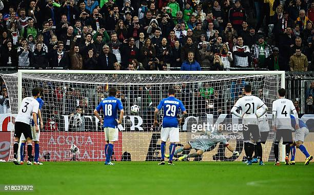 Mesut Oezil of Germany scores a penalty goal past Gianluigi Buffon of Italy during the International Friendly match between Germany and Italy at...