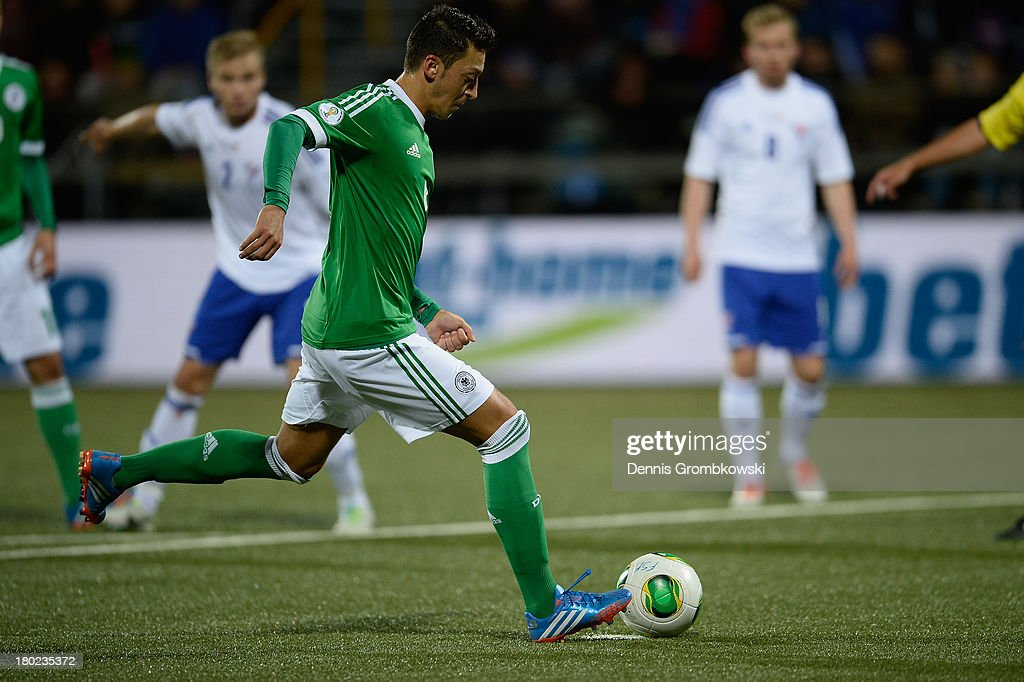 Mesut Oezil of Germany scores his team's second goal during the FIFA 2014 World Cup Qualifier match between Faeroe Islands and Germany on September 10, 2013 in Torshavn, Denmark.