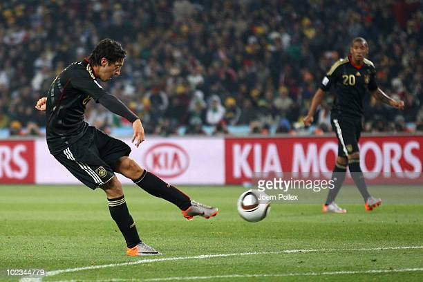 Mesut Oezil of Germany scores the opening goal during the 2010 FIFA World Cup South Africa Group D match between Ghana and Germany at Soccer City...