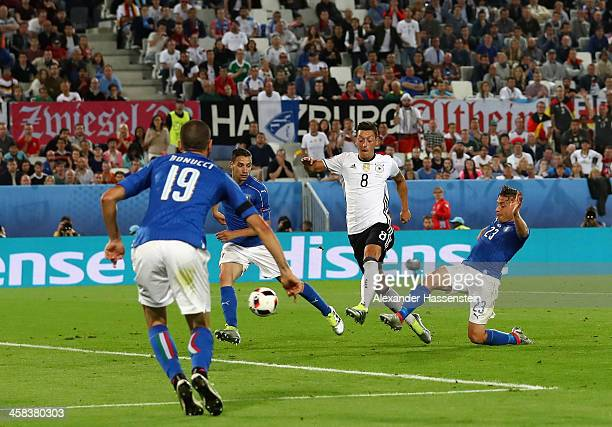 Mesut Oezil of Germany scores the opening goal during the UEFA EURO 2016 quarter final match between Germany and Italy at Stade Matmut Atlantique on...