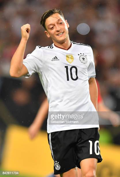 Mesut Oezil of Germany smiles after missing a chance during the FIFA 2018 World Cup Qualifier between Germany and Norway at MercedesBenz Arena on...