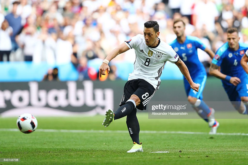 <a gi-track='captionPersonalityLinkClicked' href=/galleries/search?phrase=Mesut+Oezil&family=editorial&specificpeople=764075 ng-click='$event.stopPropagation()'>Mesut Oezil</a> of Germany takes a penalty saved by Matus Kozacik of Slovakia (not pictured) during the UEFA EURO 2016 round of 16 match between Germany and Slovakia at Stade Pierre-Mauroy on June 26, 2016 in Lille, France.