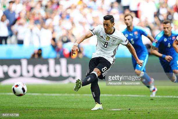 Mesut Oezil of Germany takes a penalty saved by Matus Kozacik of Slovakia during the UEFA EURO 2016 round of 16 match between Germany and Slovakia at...