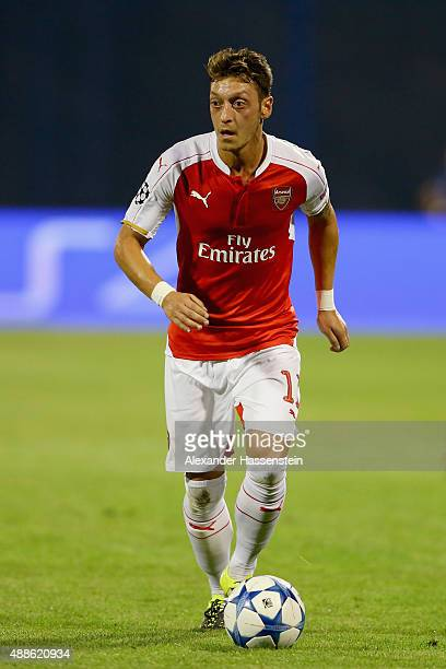 Mesut Oezil of Londons runs with the ball during the UEFA Champions League Group F match between Dinamo Zagreb and Arsenal at Maksimir Stadium on...