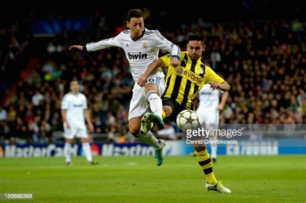 Mesut Oezil of Madrid and Ilkay Guendogan of Dortmund battle for the ball during the UEFA Champions League Group D match between Real Madrid and...
