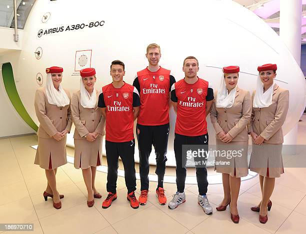 Mesut Oezil Per Mertesacker and Lukas Podolski of Arsenalat the Emirates Aviation Experience on October 31 2013 in Greenwich England