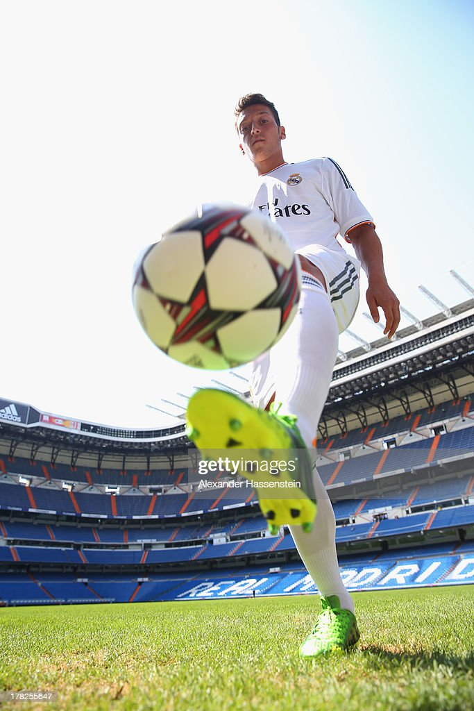 <a gi-track='captionPersonalityLinkClicked' href=/galleries/search?phrase=Mesut+Oezil&family=editorial&specificpeople=764075 ng-click='$event.stopPropagation()'>Mesut Oezil</a> plays with the ball after the adidas presentation of the new campaign Welcoming Mesut to the family in the adidas store at the Estdaio Bernabéu on August 28, 2013 in Madrid, Spain.