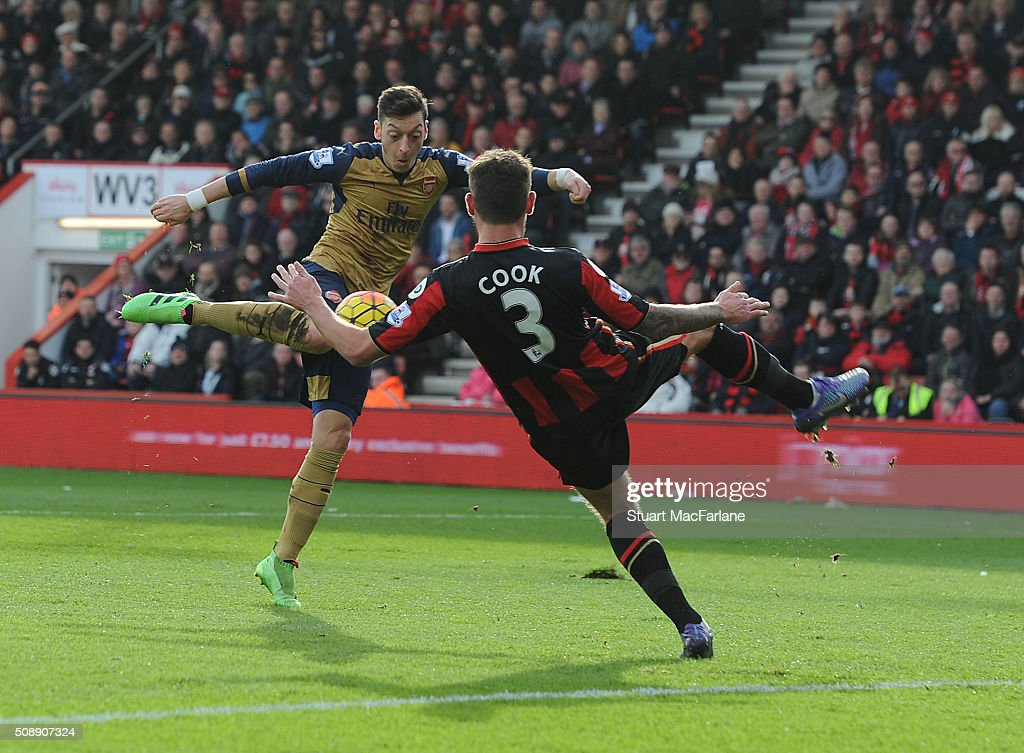 Mesut Oezil scores the first Arsenal goal during the Barclays Premier League match between AFC Bournemouth and Arsenal at The Vitality Stadium on February 7, 2016 in Bournemouth, England. (Photo by Stuart MacFarlane/Arsenal FC via Getty Images