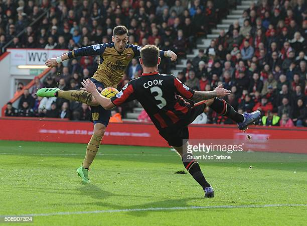 Mesut Oezil scores the first Arsenal goal during the Barclays Premier League match between AFC Bournemouth and Arsenal at The Vitality Stadium on...