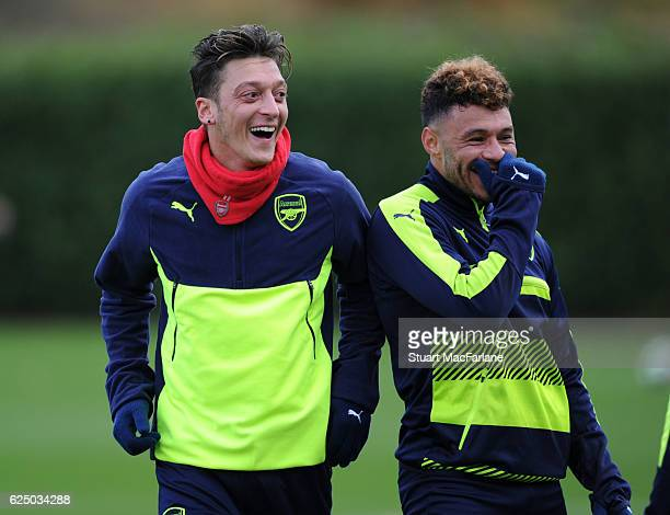 Mesut Ozil and Alex OxladeChamberlain of Arsenal during a training session at London Colney on November 22 2016 in St Albans England
