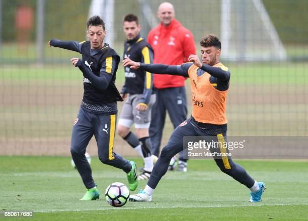 Mesut Ozil and Alex OxladeChamberlain of Arsenal during a training session at London Colney on May 9 2017 in St Albans England
