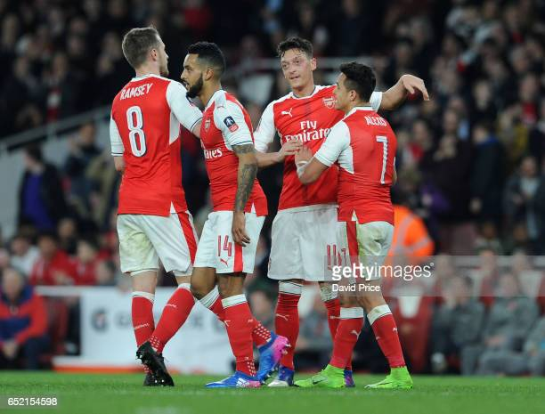 Mesut Ozil and Alexis Sanchez celebrate Arsenal's 3rd goal during the match between Arsenal and Lincoln City at Emirates Stadium on March 11 2017 in...