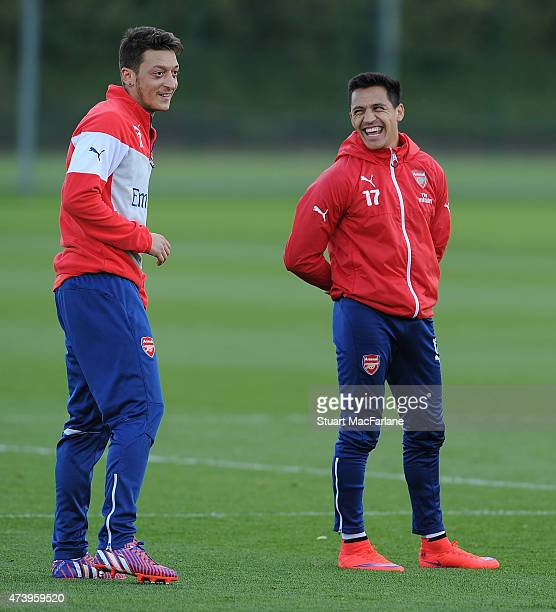 Mesut Ozil and Alexis Sanchez of Arsenal during a training session at London Colney on May 19 2015 in St Albans England