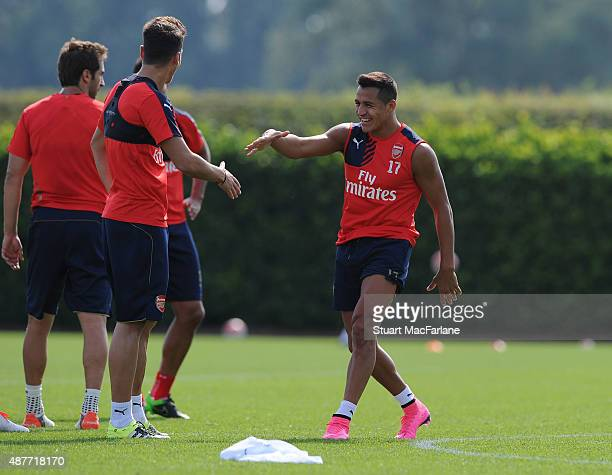 Mesut Ozil and Alexis Sanchez of Arsenal during a training session at London Colney on September 11 2015